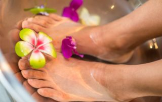 Feet in bath with flowers